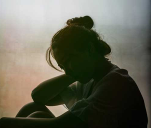 Silhouette of depressed woman